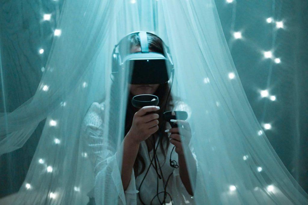 A girl playing virtual reality game